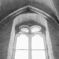 Oculus de l'éclairage primitif de la chapelle haute transformé ultérieurement en fenêtre (1982)