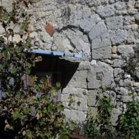 Porte romane au mur nord-ouest  de la nef (2016)